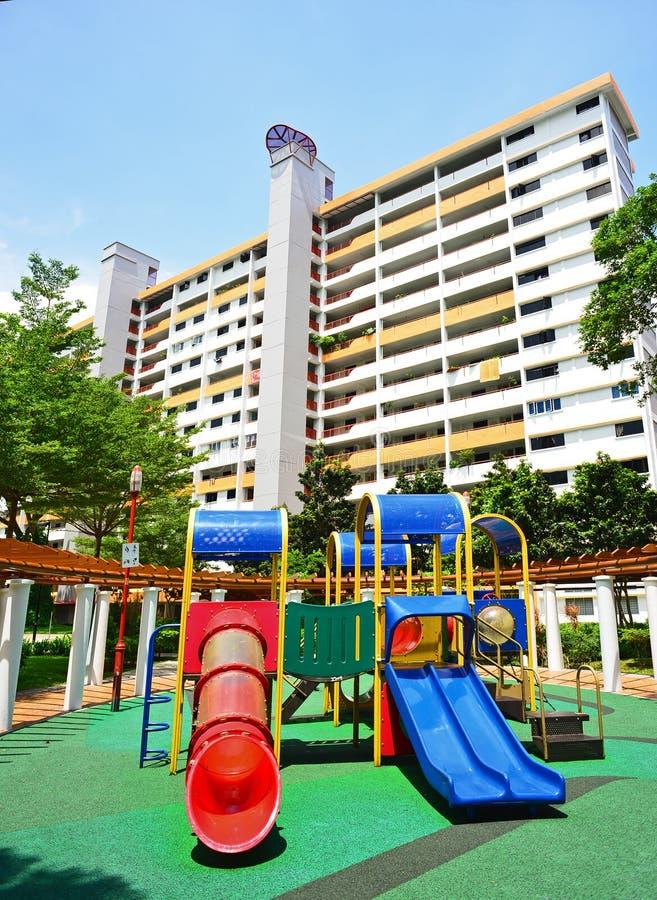 Lekplats och hus i Singapore arkivfoto