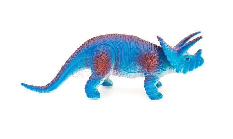 Leksak för triceratops för blått för sidosikt på vit bakgrund arkivfoton