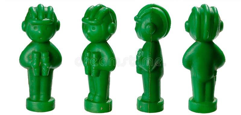 Leksakplast-soldater med tankmen i en hjälm och med isolerad kikare arkivbilder