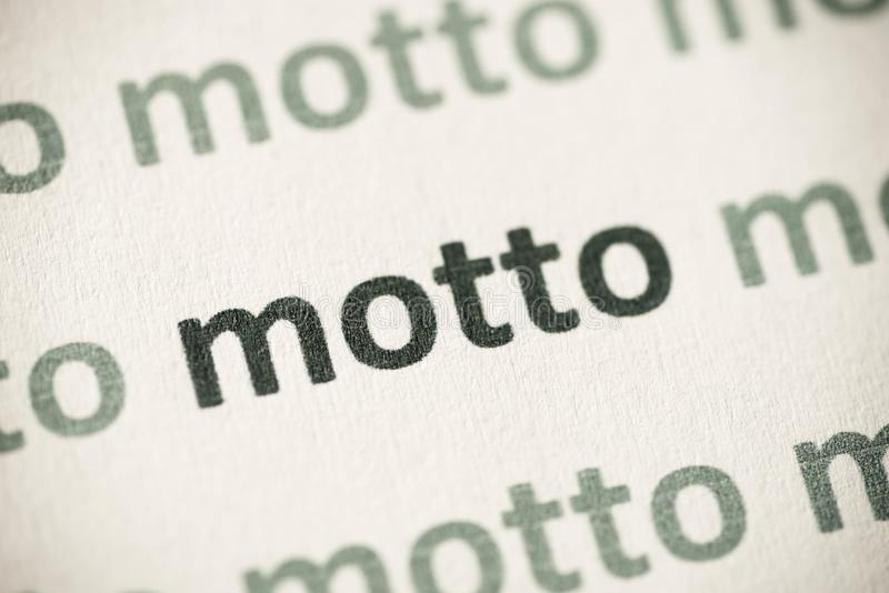 Lema de la palabra impreso en la macro de papel fotografía de archivo