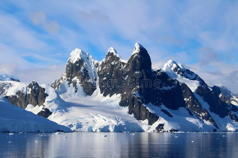 Lemaire Channel, Antarctic Peninsula, Antarctica. The peaks covered with snow of the mountains around Lemaire Channel, Antarctic Peninsula, Antarctica royalty free stock photography