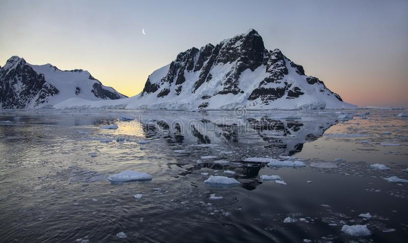 Lemaire Channel - Antarctic Peninsula - Antarctica. The Lemaire Channel in the light of the midnight sun. Antarctic Peninsula in Antarctica royalty free stock images