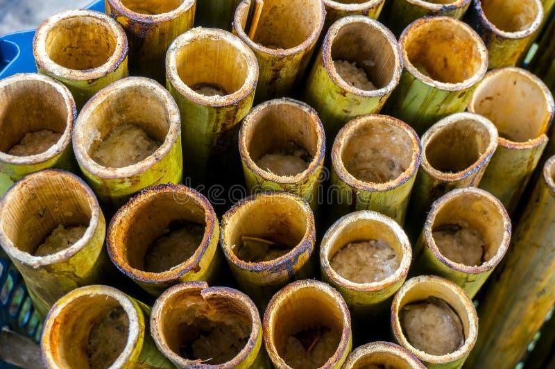 Lemang in a hollowed bamboo stick. Lemang already cooked in a hollowed bamboo stick royalty free stock photos