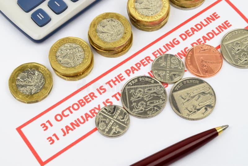 Lembrete BRITÂNICO da declaração de rendimentos foto de stock royalty free