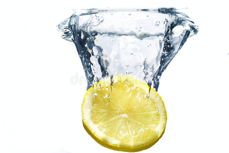 Lemon. Faling to the water stock photography