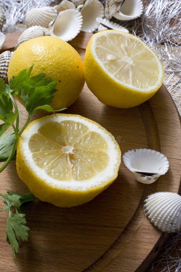 Free Lemon And Seashells Royalty Free Stock Image - 5605006