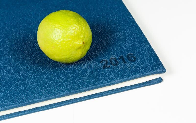 Lemon on blue diary. Of year 2016 royalty free stock photos