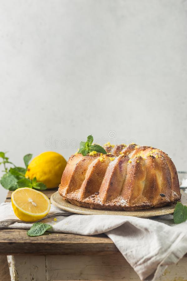 Lemon bundt cake. Homemade lemon bundt cake with icing sugar on a black background royalty free stock image