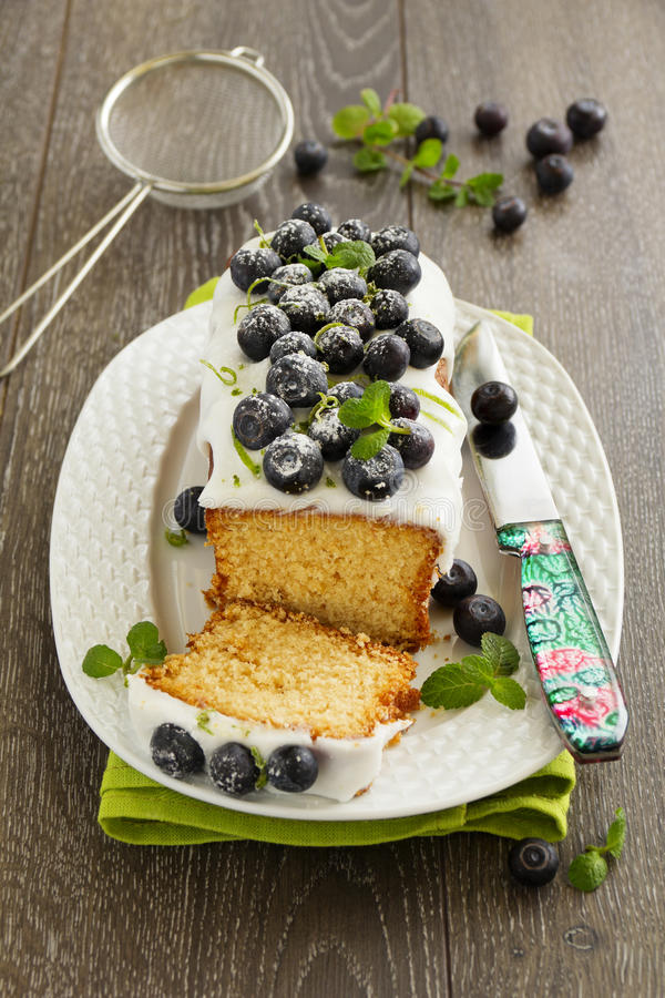 Lemon cake. With blueberry glaze royalty free stock photo