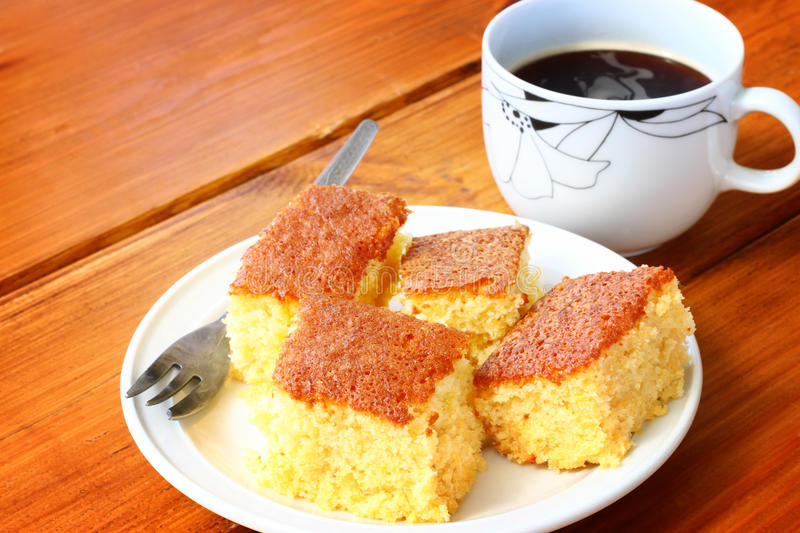Download Lemon Cake And Cup Of Coffee On Wooden Table Stock Photo - Image: 35648078
