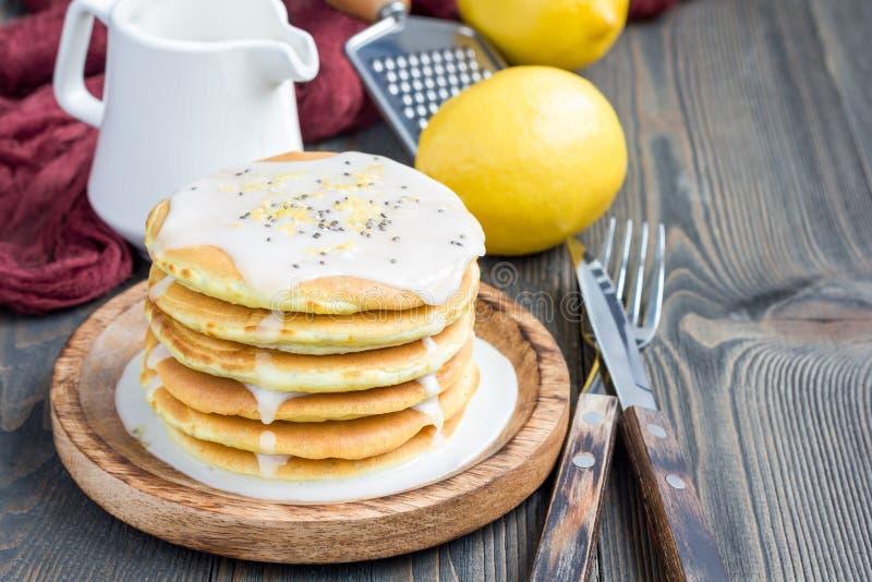 Lemon and chia seed pancakes with citrus glaze, horizontal, copy space. Homemade lemon and chia seed pancakes with citrus glaze, horizontal, copy space royalty free stock photos