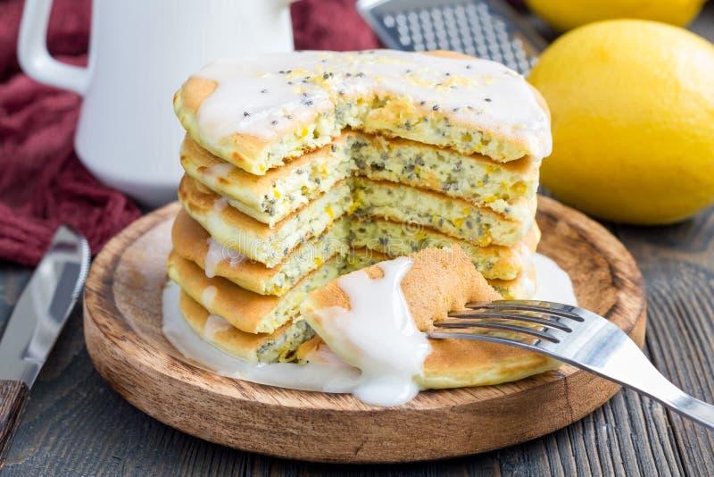 Lemon and chia seed pancakes with citrus glaze, horizontal. Homemade lemon and chia seed pancakes with citrus glaze, horizontal royalty free stock photos