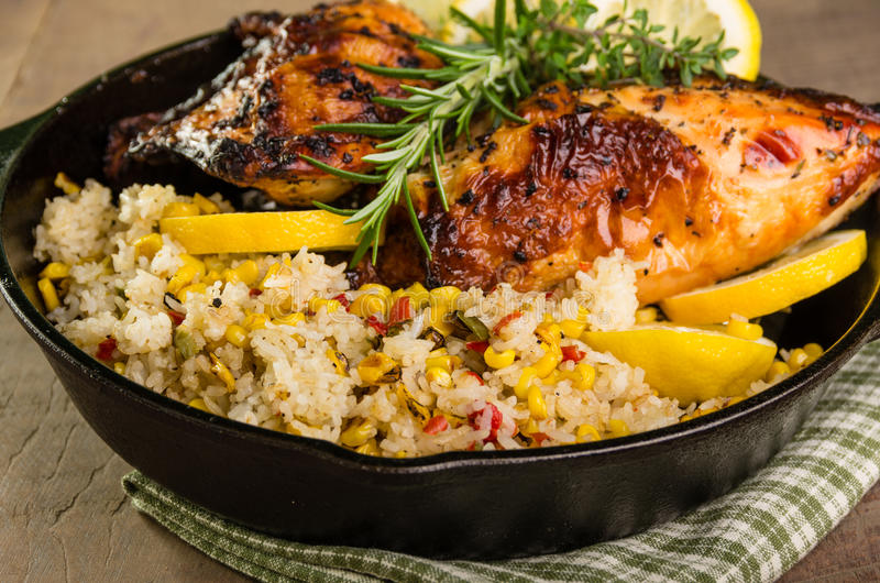 Lemon chicken with rice and roasted corn stock image