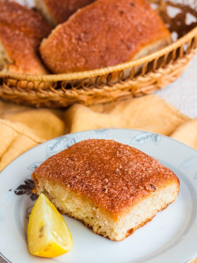 Lemon cinnamon rolls on a wooden background. Sweet pastries stock photo
