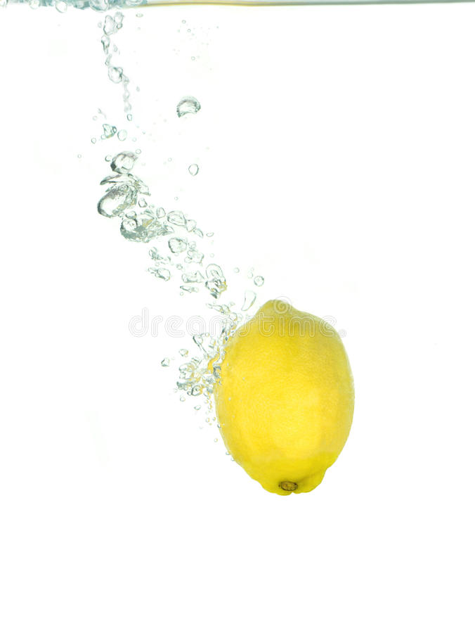 A lemon in clear water royalty free stock photography