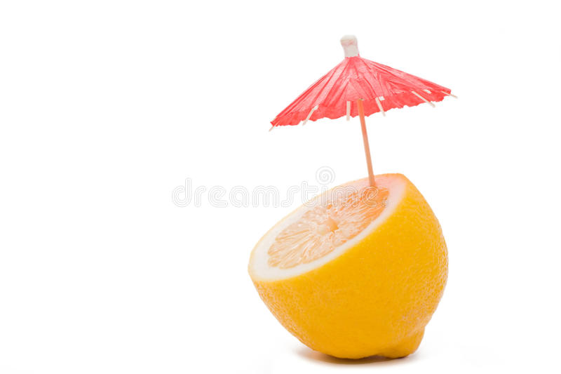 Lemon with a cocktail umbrella stock image