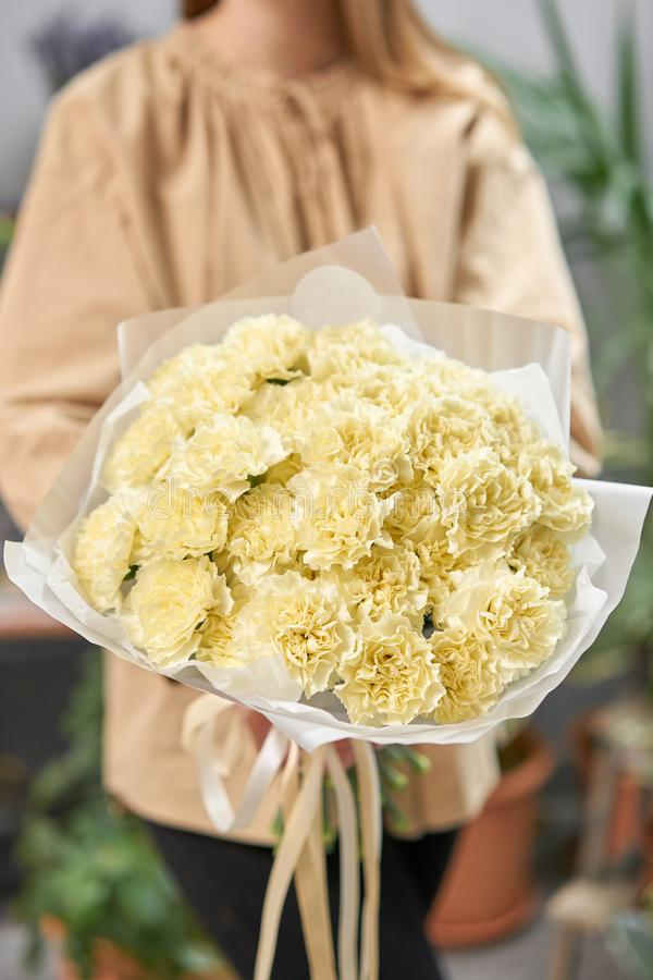 Free Lemon Color Mono Bouquet Of Carnation In Womans Hands. European Floral Shop. The Work Of The Florist At A Flower Shop Royalty Free Stock Photos - 164782908