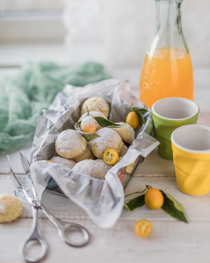 Lemon cookie in a metal box on a white wooden table stock photography