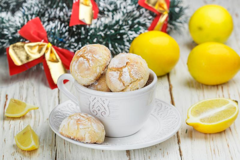Lemon cookie with powdered sugar in a white Cup royalty free stock image