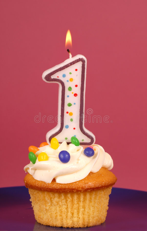 Free Lemon Cupcake With Buttercream And A  1 Candle Stock Photography - 5198382