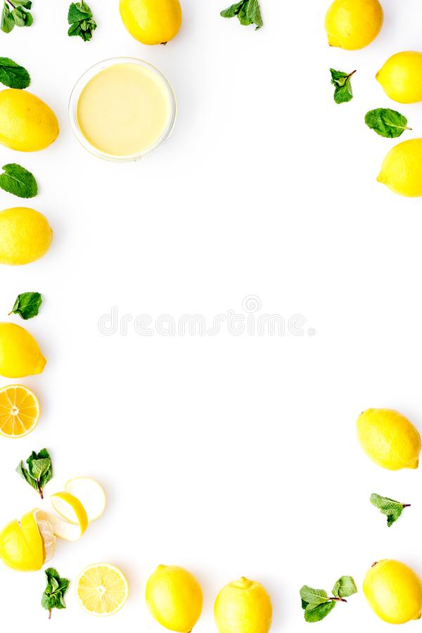 Lemon curd in bowl among lemons on white background top view copy space stock images