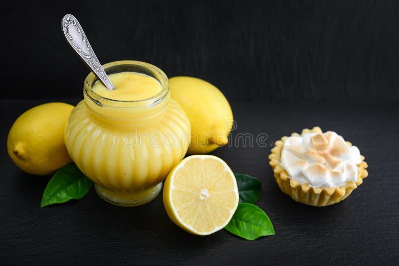 Lemon curd in jar royalty free stock images
