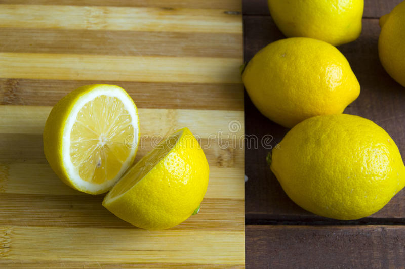 When the lemon is cut,Fresh juicy lemon on top of the salad and fresh for the fish,. Knife and lemon pictures ready to cut on the table,Fresh juicy lemon on top stock images