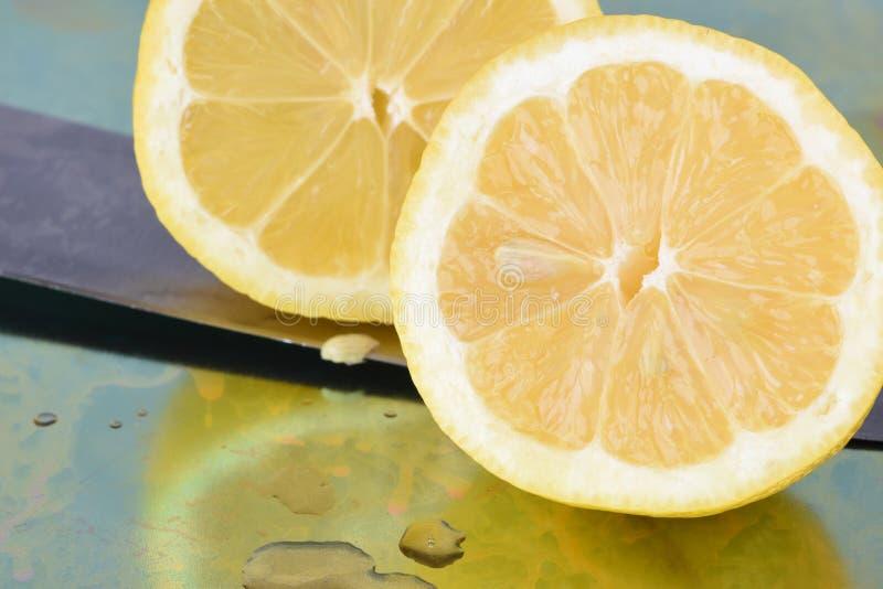 Lemon cut and knife stock photography