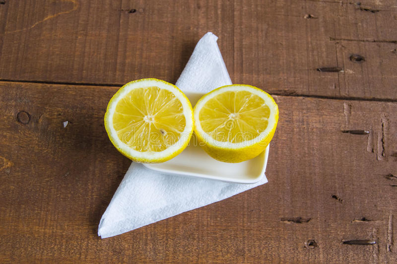 When the lemon is cut,Ready-to-serve lemon pictures,. Knife and lemon pictures ready to cut on the table,Fresh juicy lemon on top of the salad and fresh for the royalty free stock images