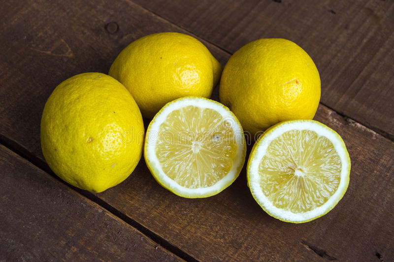 When the lemon is cut,Ready-to-serve lemon pictures,. Knife and lemon pictures ready to cut on the table,Fresh juicy lemon on top of the salad and fresh for the royalty free stock photography