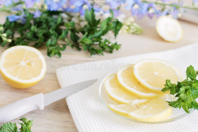 Lemon is cut into slices, the process of cooking lemon dishes, juicy pieces of tropical fruits, dietary fruits, healthy foods, ing stock image