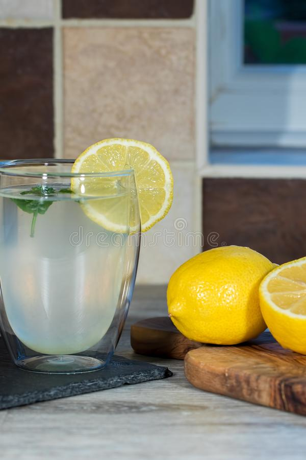 Lemon drink. Authentic glass of home-made lemonade. Refreshing summer beverage stock photos