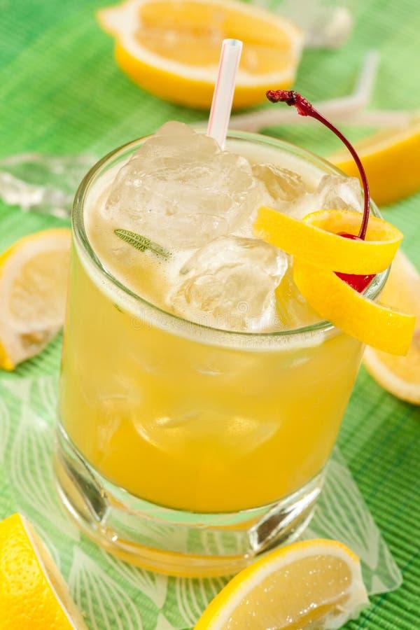 Lemon drink on a green background. Lemon drink and ice on a green background stock image