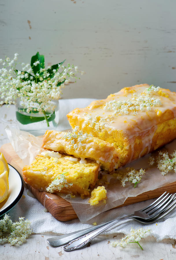 LEMON and ELDERFLOWER DRIZZLE CAKE. Vintage style.selective focus stock photography