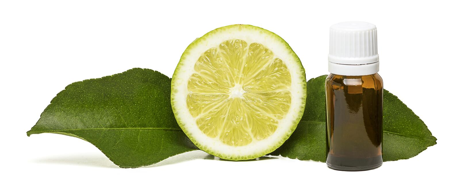 Lemon essential oil with two side leaves royalty free stock photography