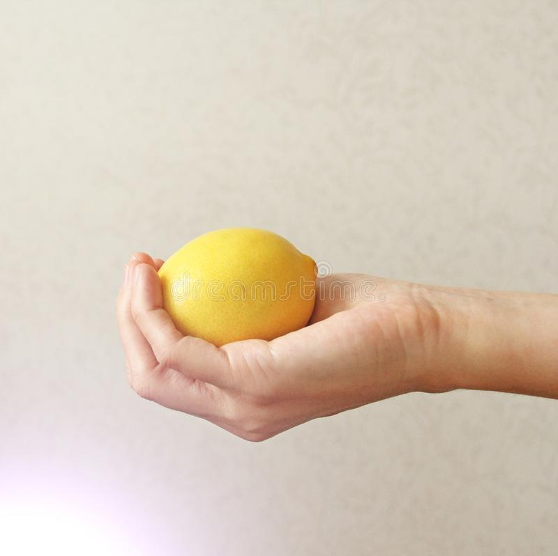 Lemon. The fruit of Yellow Lemon Lies on the Hand royalty free stock photo