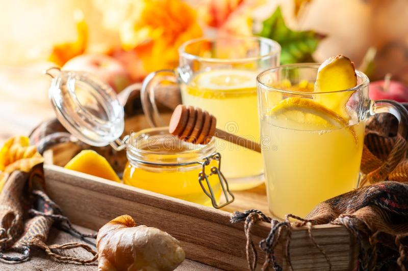 Lemon and ginger tea with honey. Spicy medicinal tea for autumn-winter season royalty free stock image