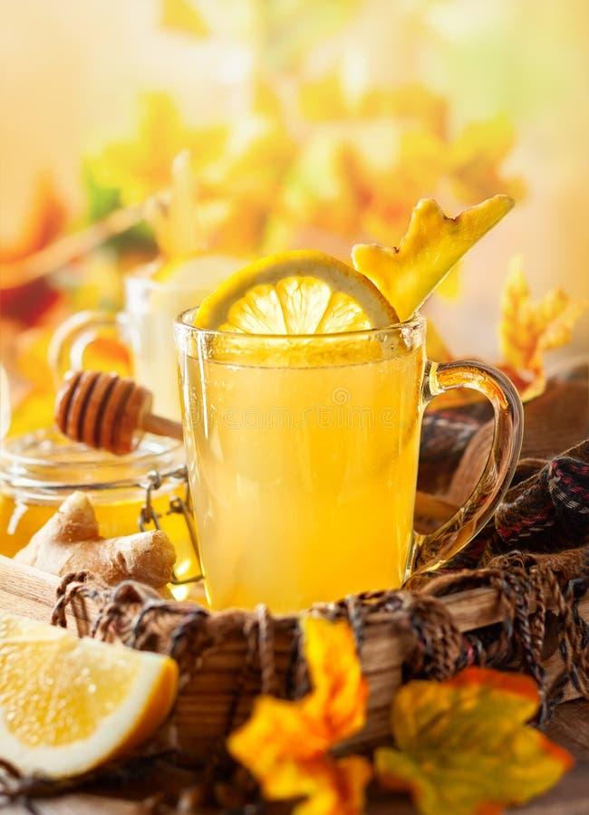 Lemon and ginger tea with honey. Spicy medicinal tea for autumn-winter season royalty free stock photos