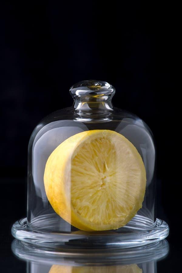 Lemon in a glass vase stock photo