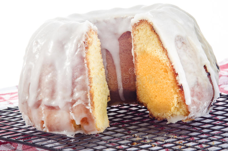 Lemon gugelhupf with icing sugar stock images