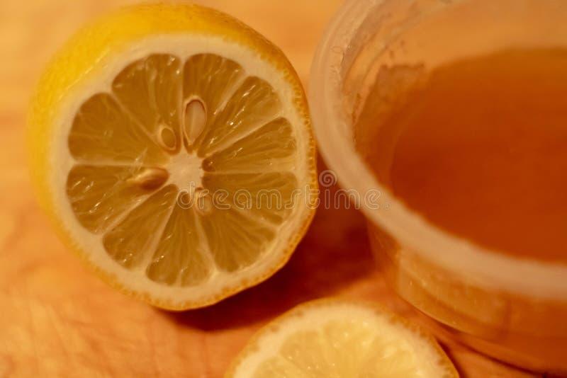 Lemon and honey on the wooden background. Food fruit vitamin wood stock photo