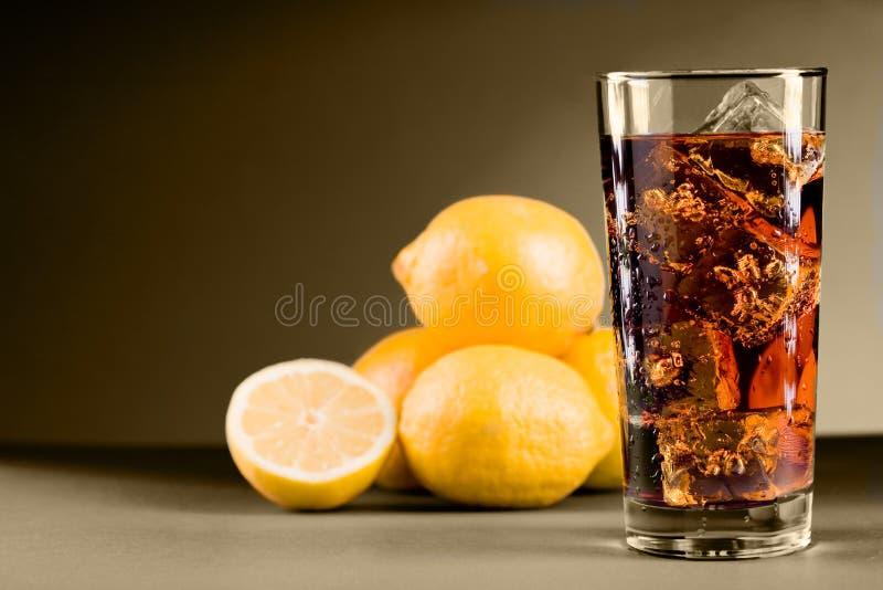 Lemon Ice Tea. Photo of delicious lemon ice team with ice cubes on sepia background stock photos