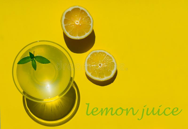 Lemon juice is isolated on a yellow background. View from the top. Copy space. royalty free stock photos