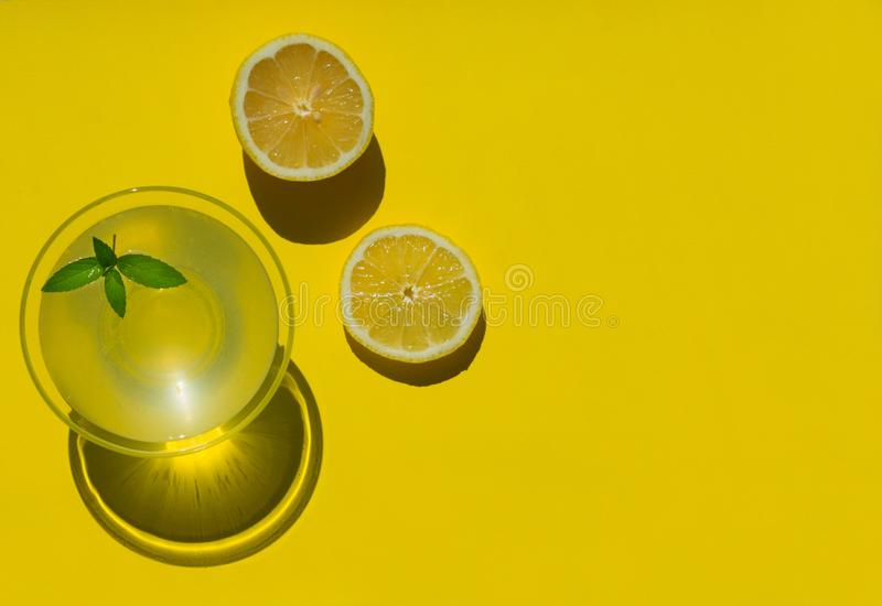 Lemon juice is isolated on a yellow background. View from the top. Copy space. stock photography