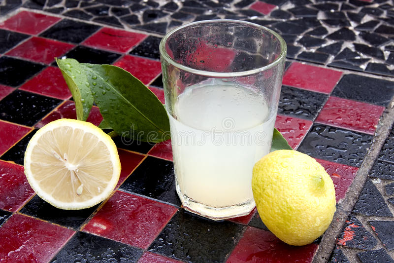 Lemon juice and lemon royalty free stock images
