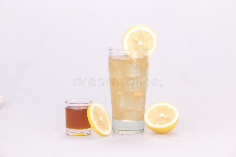 Lemon juice mixed with honey. Taste sweet white backdrop royalty free stock photography