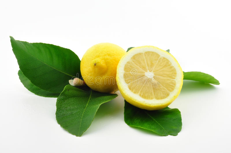 Download Lemon And Lemon Half With Leaves Stock Image - Image of yellow, juice: 15466415