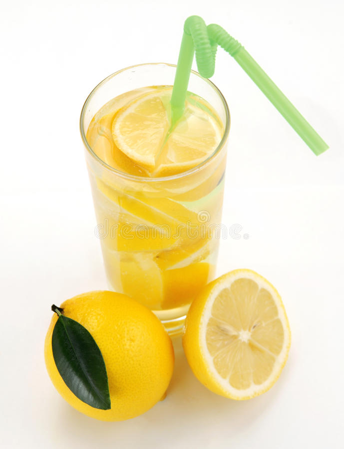 Lemon and lemonade. In a glass royalty free stock photography