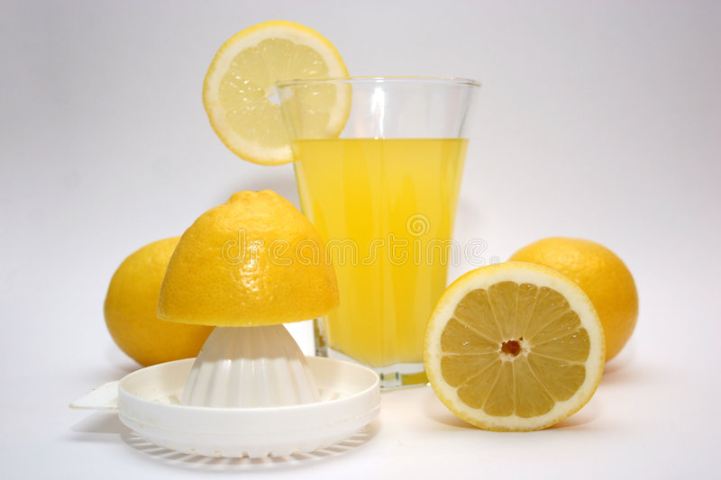 LEMON, LEMONADE. Lemon and lemonade with squeezer in isolated stock image