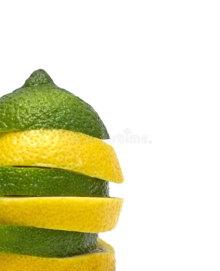 Lemon and lime. Closeup of lemon and lime slices stock photos